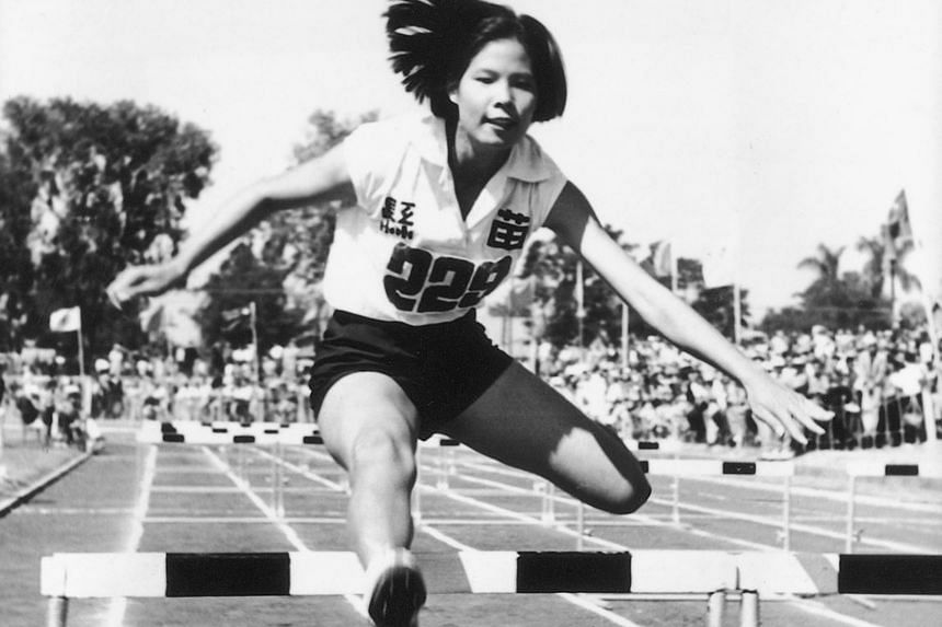 Taiwanese runner Chi Cheng, who once held six world records in athletics, competing in the hurdles in her younger days.