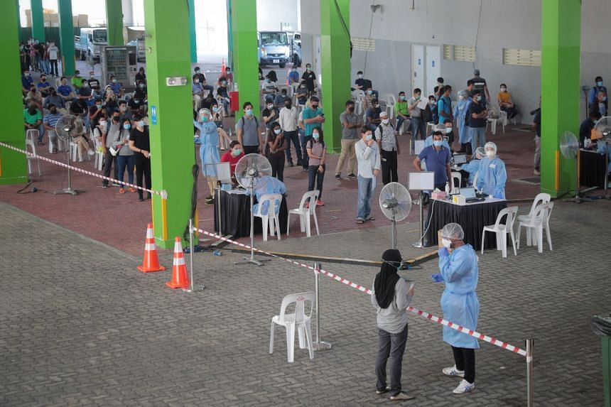 Essential workers being screened for Covid-19 at the regional screening centre at The Float @ Marina Bay on June 9, 2020.