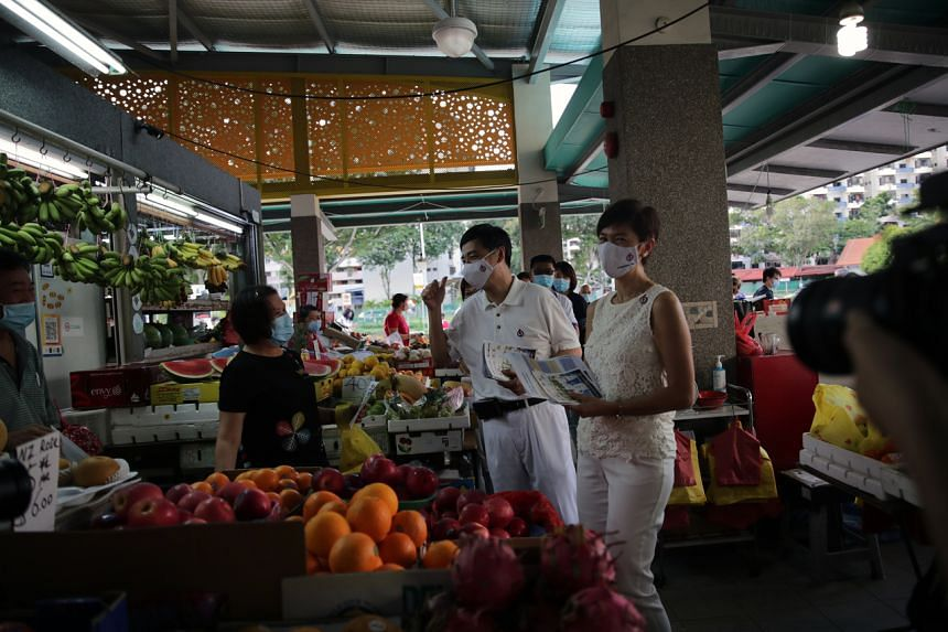 The PAP's Jalan Besar GRC candidates Josephine Teo and Heng Chee How during a walkabout at Whampoa Market on July 5, 2020.