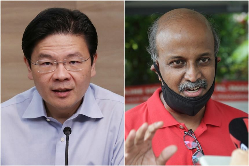 National Development Minister Lawrence Wong (left) also addressed Professor Paul Tambyah's remarks that the MOM was to blame for an advisory that asked employers not to get workers tested.