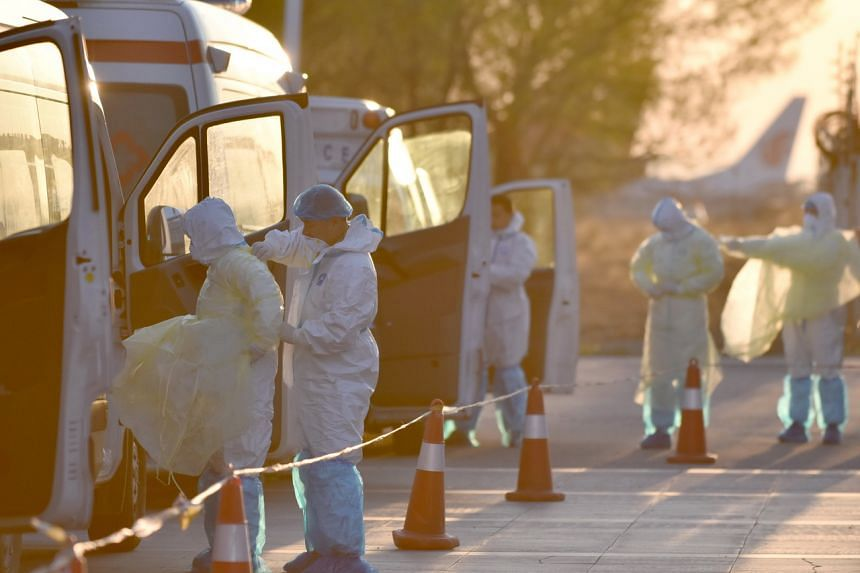 Medical workers preparing to receive passengers amid the Covid-19 pandemic at Hohhot Baita International Airport in Inner Mongolia on April 26, 2020. Medical authorities in Inner Mongolia issued an alert after a suspected case of bubonic plague.