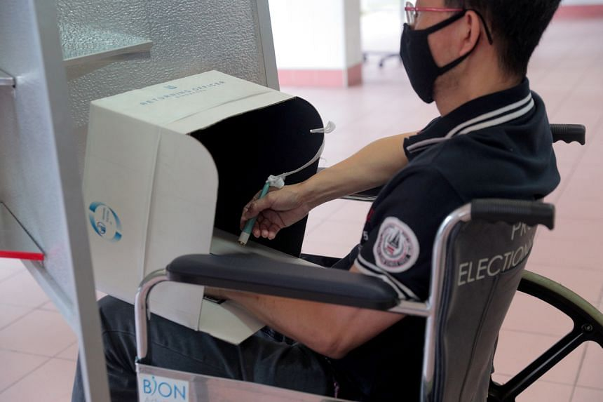 A portable booth that can be placed on laps is available for wheelchair users for them to mark their ballot papers.