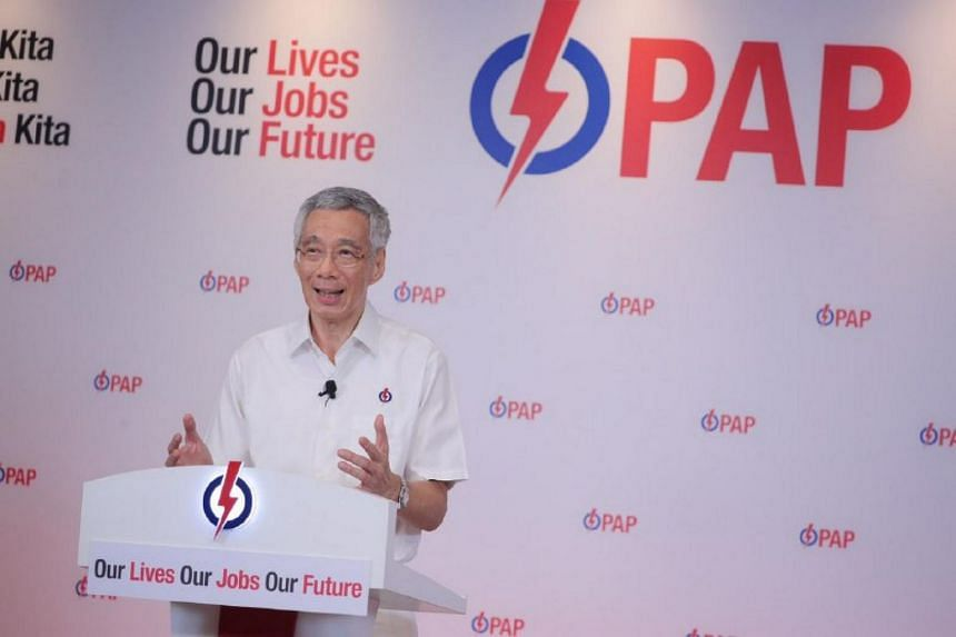 """PM Lee called on all Singaporeans to throw their support behind him and the PAP, and to be confident that """"Singapore will endure this searching trial""""."""