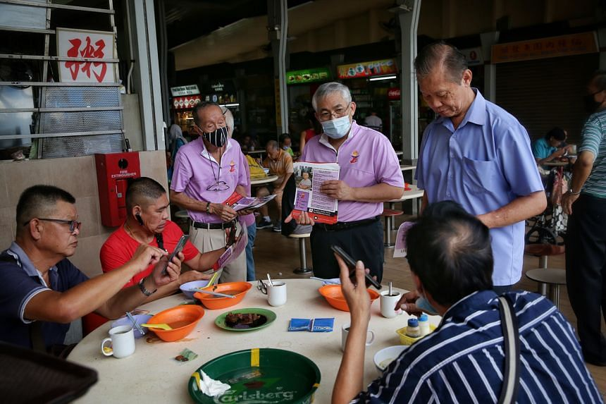 JALAN BESAR: Peoples Voice chief Lim Tean, who is leading his party's team in the GRC, speaking to patrons at Golden Mile Food Centre last Friday. MARINE PARADE:PAP candidates (from left) Edwin Tong, Mohd Fahmi Aliman, Tan Chuan-Jin and Tan See Leng