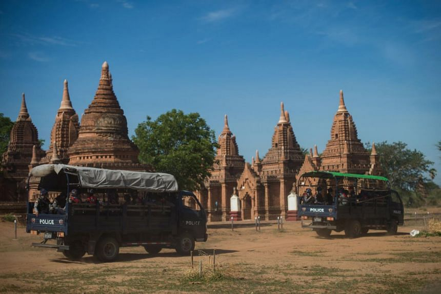 In a photo taken on June 23, 2020, members of a police squad patrol a temple complex in Bagan, Mandalay Region.