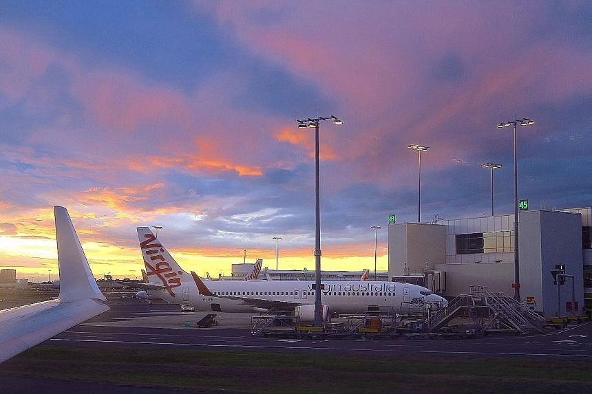 A Virgin Australia aircraft on the tarmac at the domestic terminal of Sydney Airport. Virgin Australia, 20 per cent owned by Singapore Airlines, entered voluntary administration in April owing nearly A$7 billion (S$6.8 billion) to creditors, includin