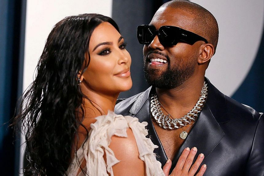 Rapper and fashion designer Kanye West (left) with his wife, reality-television star Kim Kardashian West. He had previously announced plans to run for president without doing so.