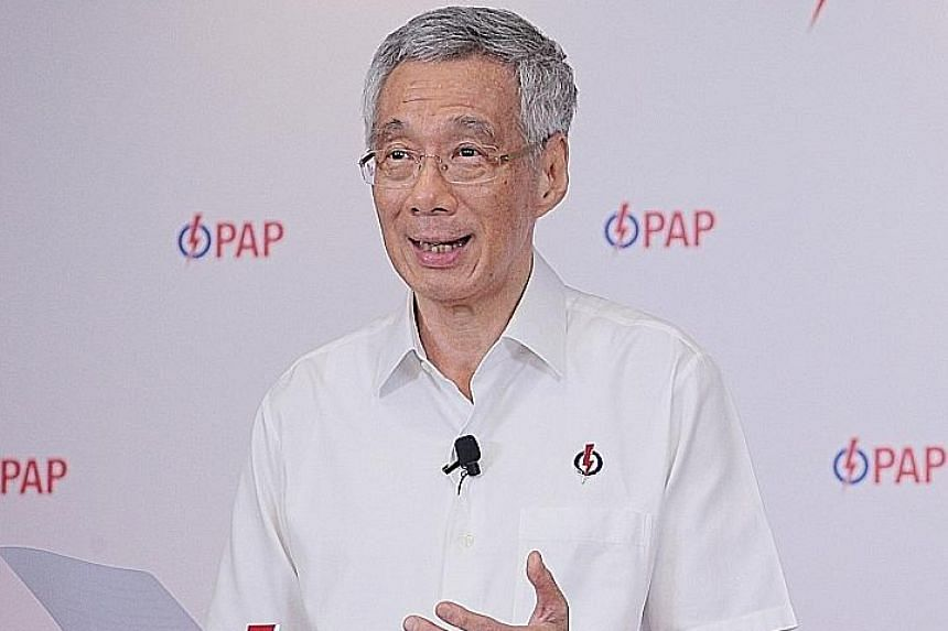 Singapore's friends and adversaries will be watching us closely, said Prime Minister Lee Hsien Loong at an online lunchtime rally yesterday. ST PHOTO: JASON QUAH