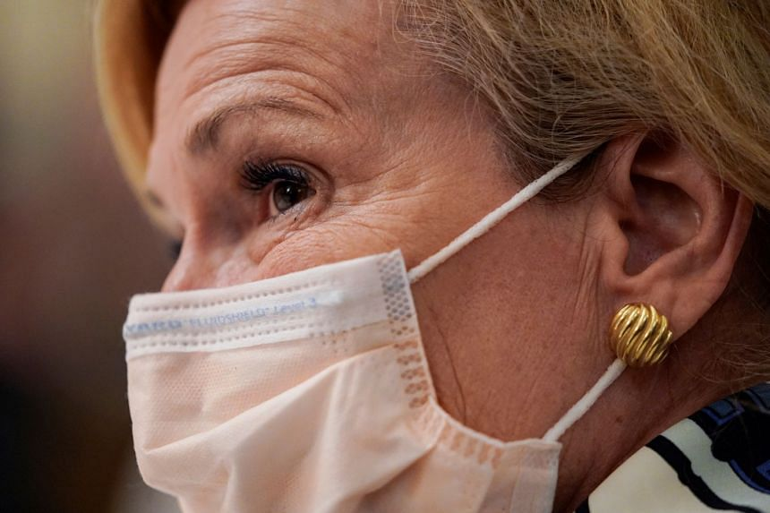 Dr Birx wears a protective face mask as she attends a White House event on reopening schools, July 7, 2020.