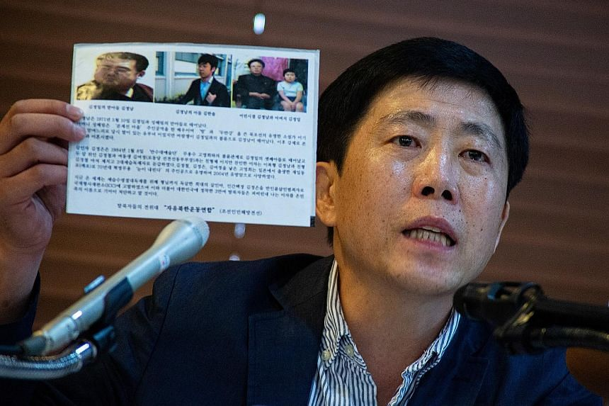 Mr Park Sang-hak, leader of the activist group Fighters for a Free North Korea, showing a propaganda leaflet while speaking about the release of fliers to North Korea at a press conference in Seoul on Monday. Mr Park Jung-oh, head of North Korean def