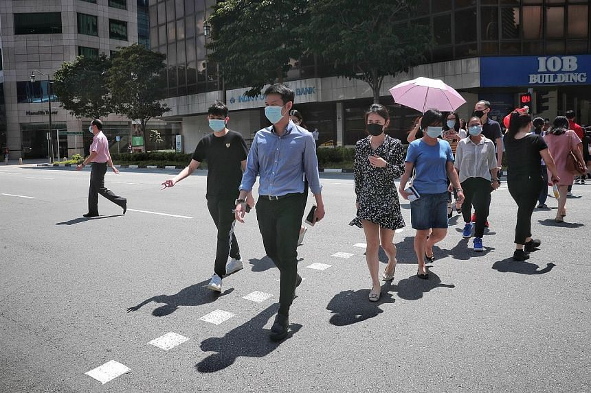 The lunchtime crowd at Cross Street during phase one last month. Amid the challenges posed by the pandemic, Mr Tharman Shanmugaratnam says the aim is to help all workers constantly improve their skills and income.