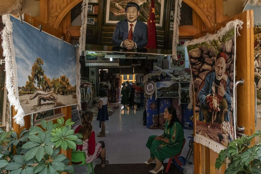 A 2019 photo shows an image of Chinese President Xi Jinping at a carpet store in Hotan, a town in Xinjiang, in China's west.