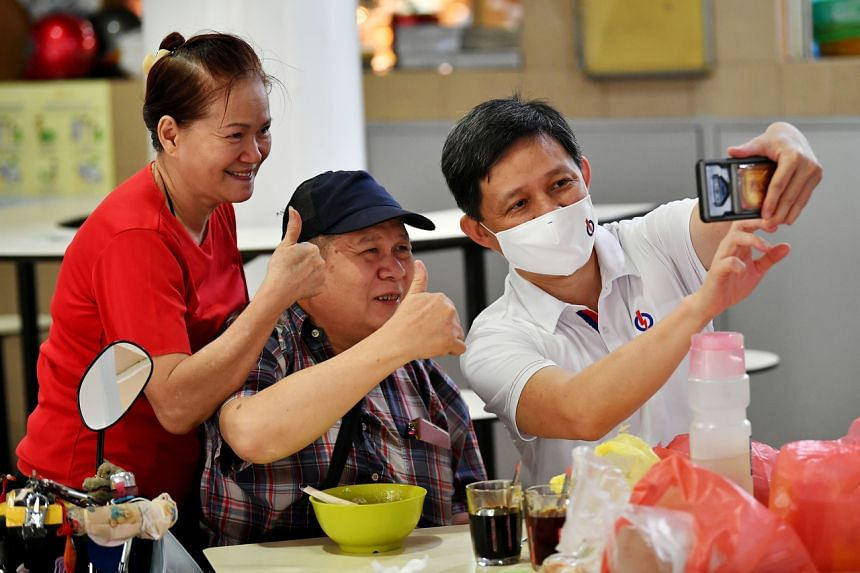 Trade and Industry Minister Chan Chun Sing during a walkabout at Pek Kio Market and Food Centre on July 2, 2020.
