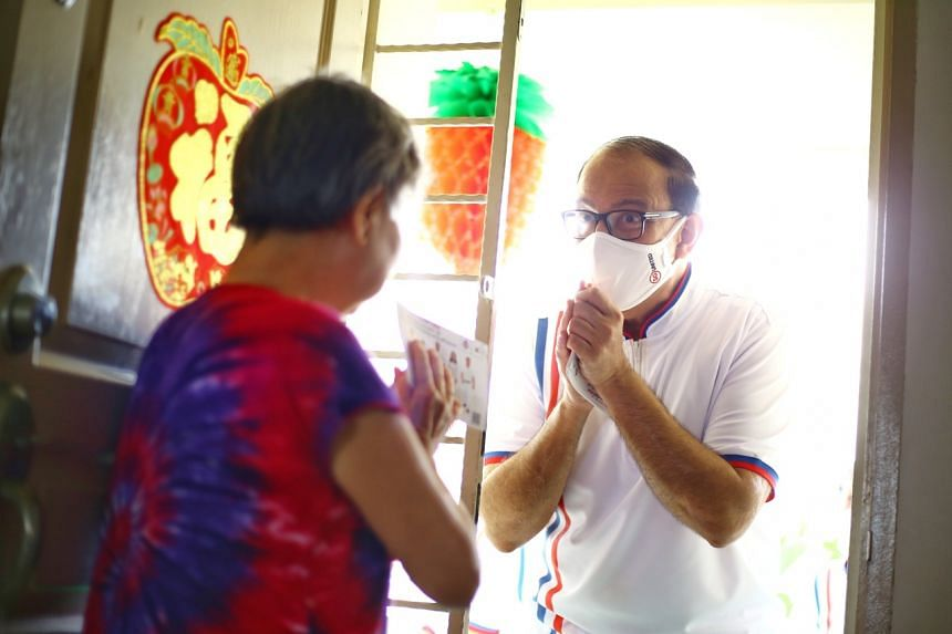 Communications and Information Minister S. Iswaran stopping at a resident's home while on house visits in Clementi West on July 8, 2020.