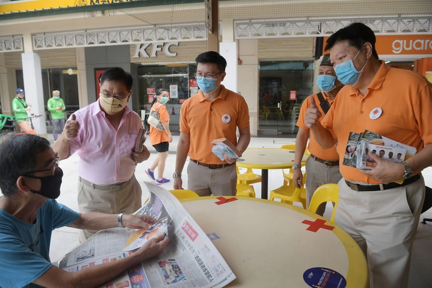 (From left) NSP founding member Ken Sun joins Sembawang GRC candidates Spencer Ng, Yadzeth Hairis and Sebastian Teo on a walkabout in Woodlands on July 2, 2020.