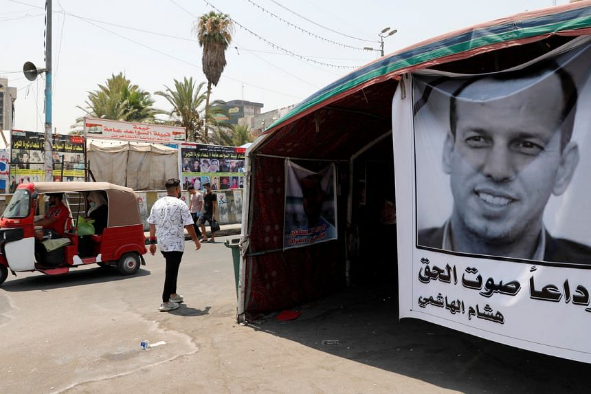 A poster depicting the former government advisor and political analyst Hisham al-Hashemi, who was killed by gunmen is seen in Baghdad, Iraq, on July 8, 2020.