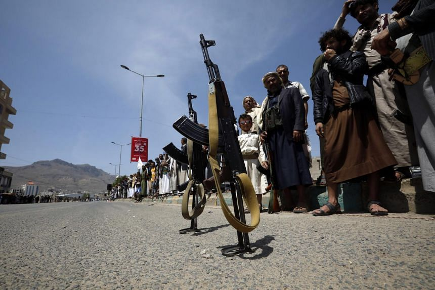 Guns are left by armed supporters of the Houthi movement in Yemen, on July 7, 2020.