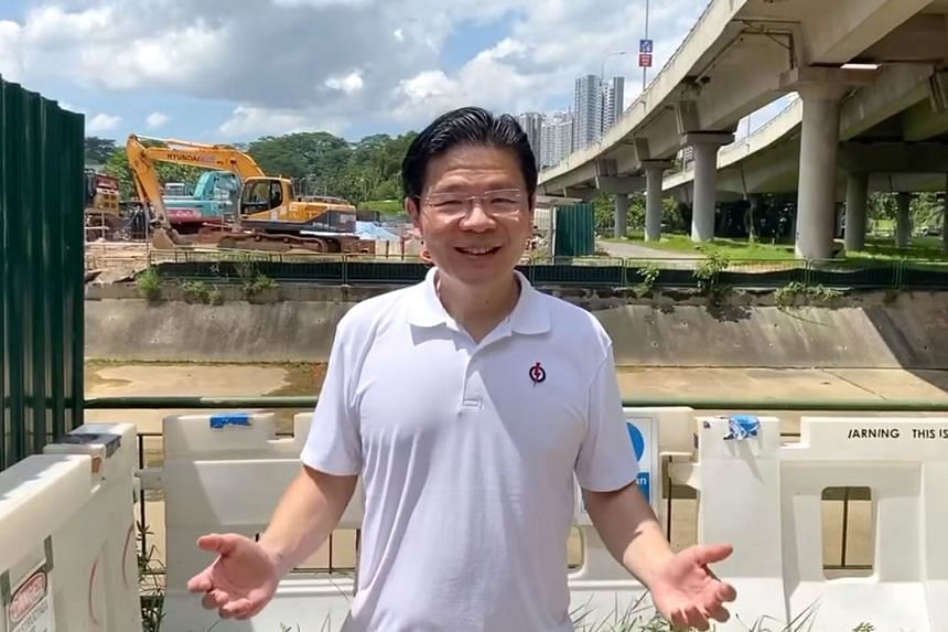 National Development Minister Lawrence Wong, who is leading the People's Action Party team in Marsiling-Yew Tee GRC, telling residents about a new bridge that will be built in Limbang in a video uploaded on Facebook yesterday.