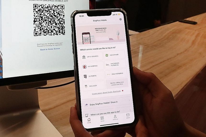 SingPass, the national authentication system that governs access to government digital services, will be updated to allow an account holder to tag family members to his mobile number to receive the one-time password via SMS. ST PHOTO: KELVIN CHNG