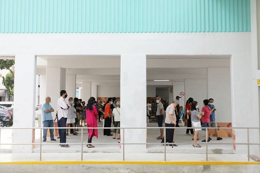 Voters queue at the void deck of 240 Serangoon Avenue 2, on July 10, 2020.