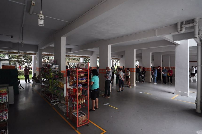 People wait to cast their votes in the multi-purpose hall located at Clementi Avenue 4, on July 10, 2020.
