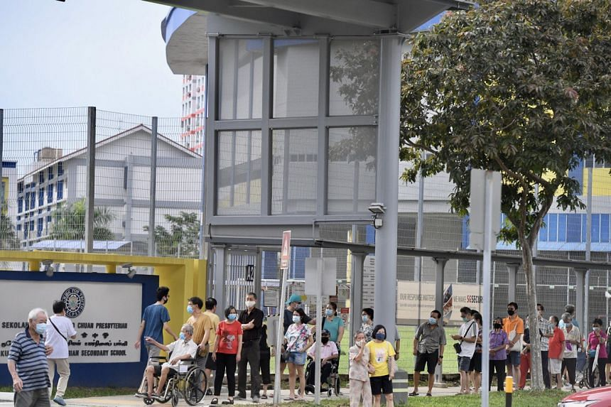 Senior residents queue outside Kuo Chuan Presbyterian Secondary School, on July 10, 2020.