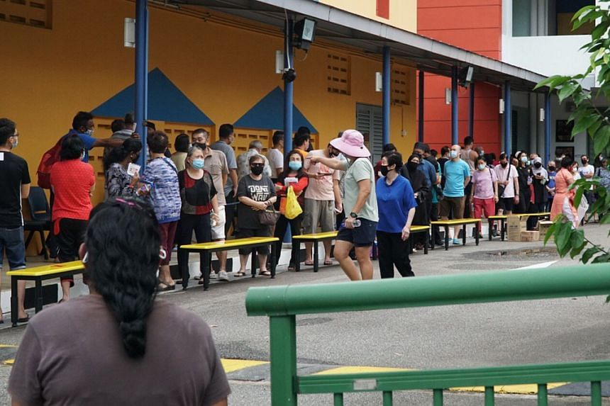 Voters queue at Woodlands Secondary School on July 10, 2020.