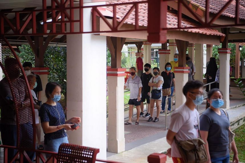 Voters at a polling station set up at 309a Jurong East Street 32 around noon, on July 10, 2020.