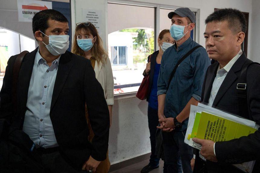 Al Jazeera journalists arrive at the Bukit Aman police headquarters in Kuala Lumpur, on July 10, 2020.