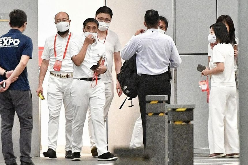DPM Heng Swee Keat (above) and other members of the PAP's East Coast team, including Senior Minister of State Maliki Osman (second from left) and Ms Cheryl Chan (right) outside the Max Atria early this morning, where they waited for the election resu