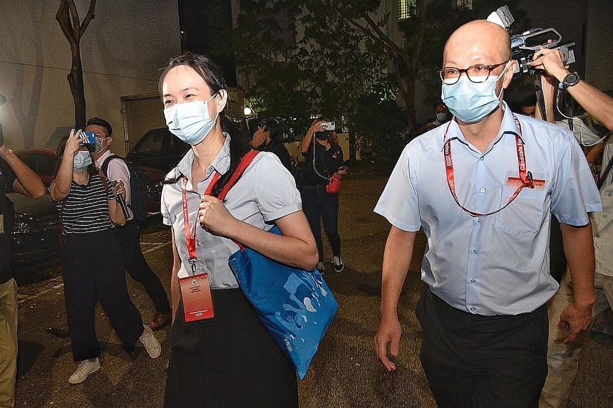 Candidates from the Workers' Party's East Coast team, Ms Nicole Seah and Mr Terence Tan, arriving at the party's headquarters last night. After the results were announced, Ms Seah thanked voters for their support, saying the team knew it would be a t