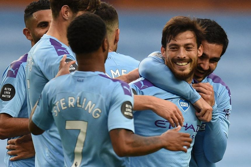 City's David Silva (second right) celebrates a goal against Newcastle United with team mates.