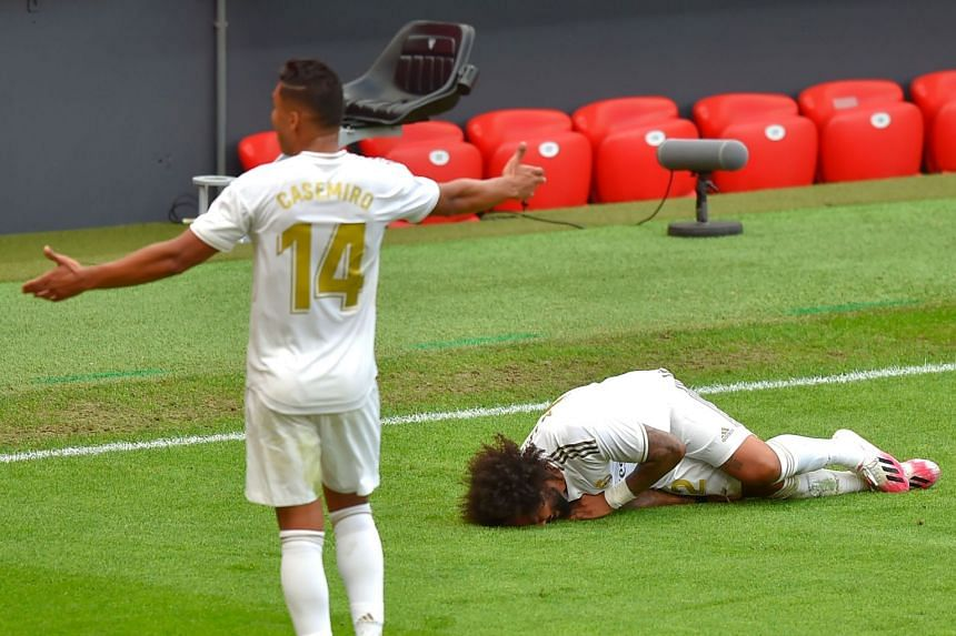 Marcelo lies on the ground after falling during the match against Athletic Bilbao.