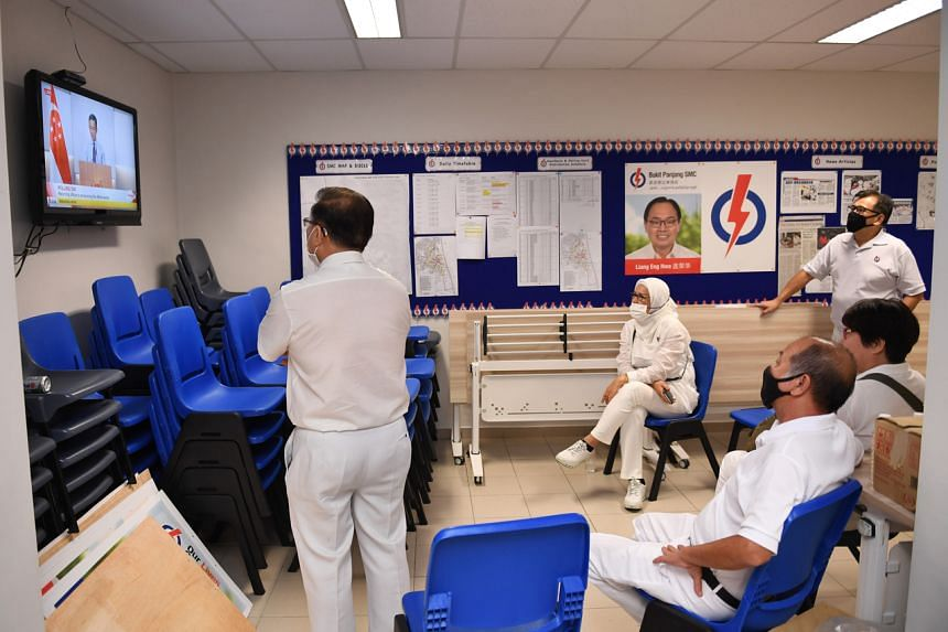 Members of the PAP Bukit Panjang branch watching the announcement of the general election results at their branch office on July 11, 2020.