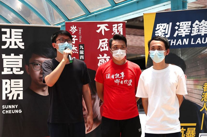 (From left) Candidates of Kowloon West constituency Sunny Cheung, Jimmy Sham and Nathan Lau at a primary election in Hong Kong, on July 11, 2020.
