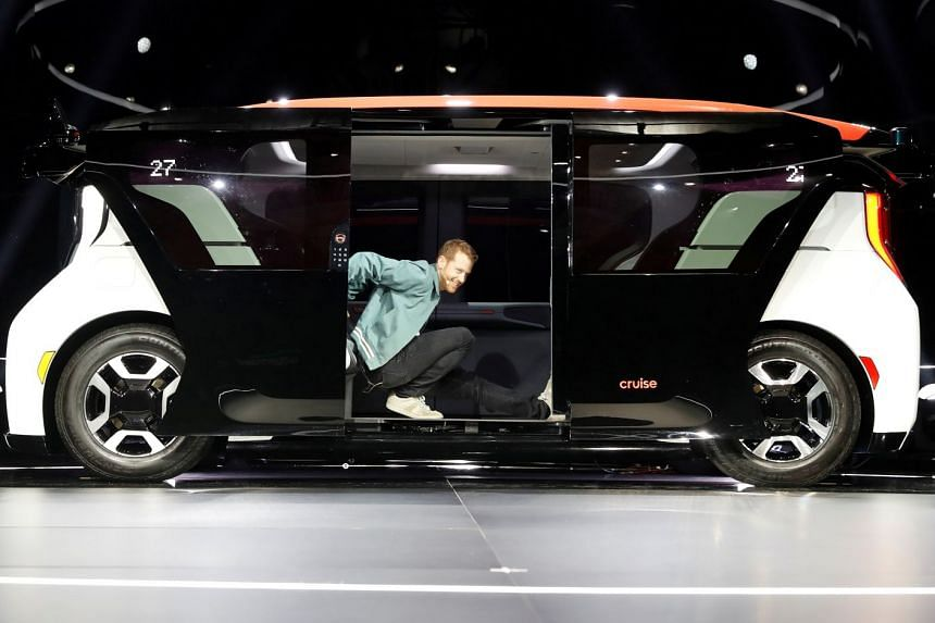 Mr Kyle Vogt, chief technology officer, president and co-founder of Cruise, a Honda and General Motors self-driving car partnership, stretches inside a Cruise Origin electric autonomous vehicle during its unveiling in San Francisco in January.