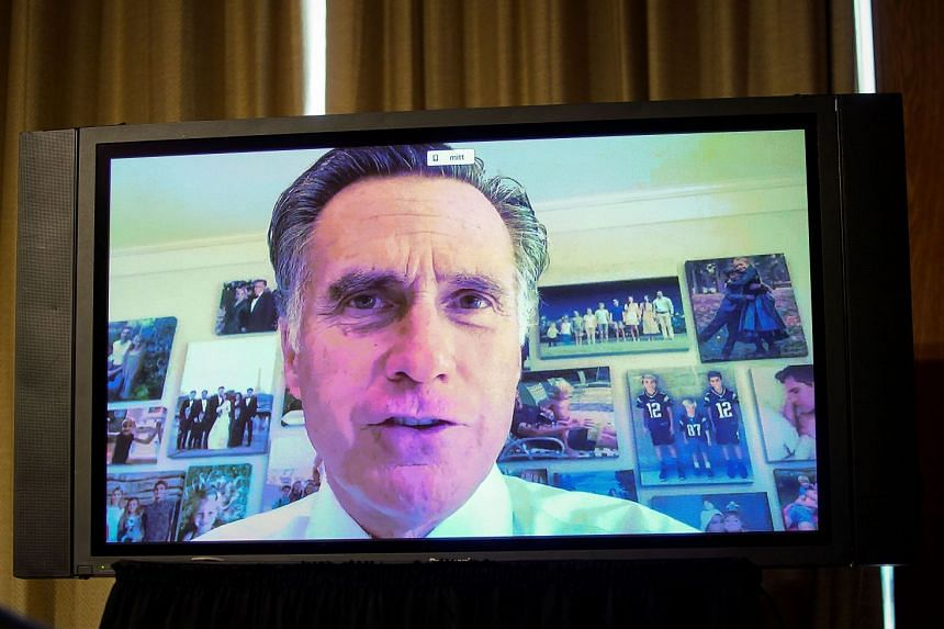 US Senator Mitt Romney is seen on a monitor as he participates remotely in a Senate hearing on June 25, 2020.