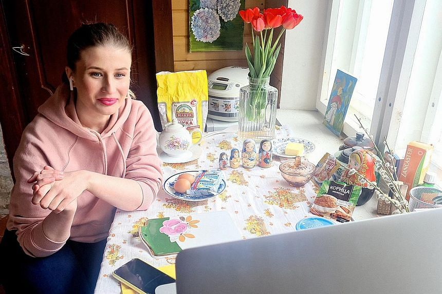 Ms Anna Belousova (above) teaches a family recipe for pancakes from her summer house outside Moscow.