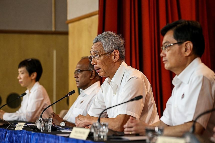 Prime Minister Lee Hsien Loong at a virtual press conference after the GE2020 results were released yesterday, flanked by (from left) Minister for Culture, Community and Youth Grace Fu, Minister for Home Affairs and Law K. Shanmugam and Deputy Prime