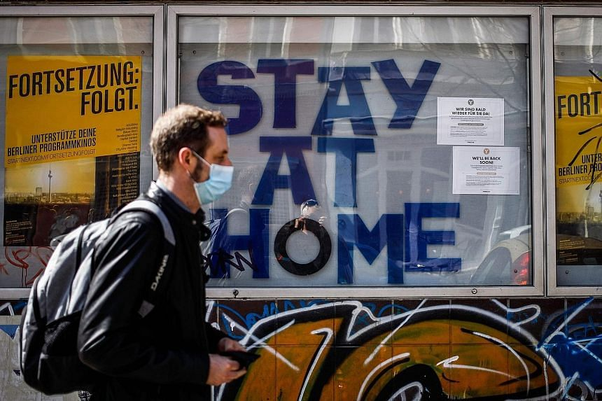 """A cinema urging people to """"Stay At Home"""" in Berlin's Kreuzberg district in April. A businessman from a car-parts company in Germany was the country's first coronavirus case on Jan 27. He had been infected by a colleague visiting from China, who had s"""