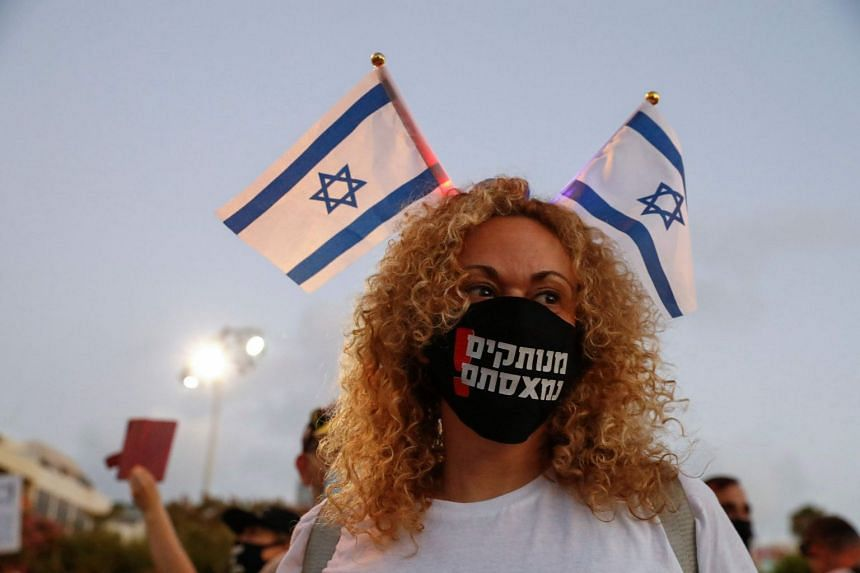 An Israeli protester takes part in a demonstration in Rabin Square in Tel Aviv, on July 11, 2020.