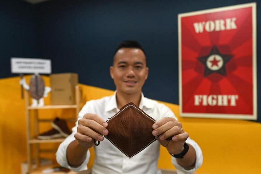 Vietnamese entrepreneur Le Thanh with a face mask made from coffee grounds at his co-working space in Ho Chi Minh City.