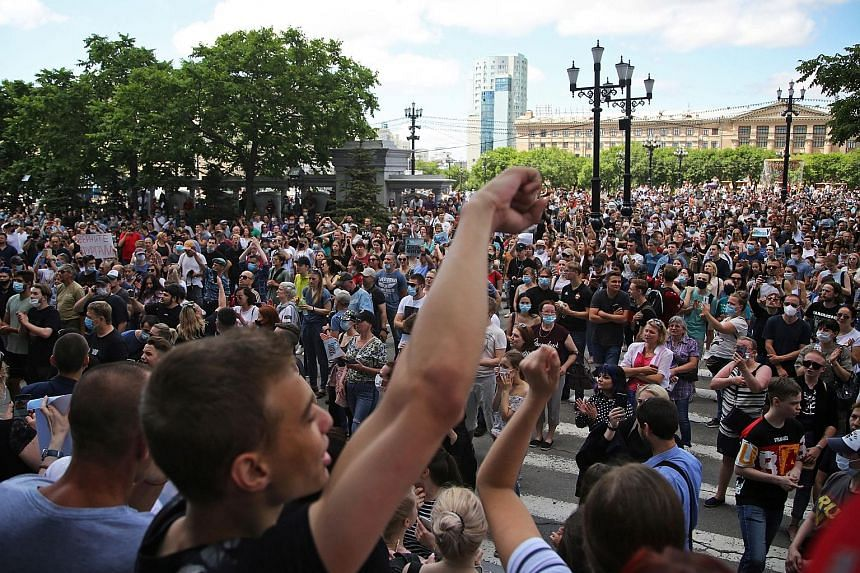 Russians in the far eastern region of Khabarovsk rallying last Saturday (above) in support of governor Sergei Furgal (left), who was arrested last week on suspicion of multiple murders. PHOTOS: REUTERS, AGENCE FRANCE-PRESSE