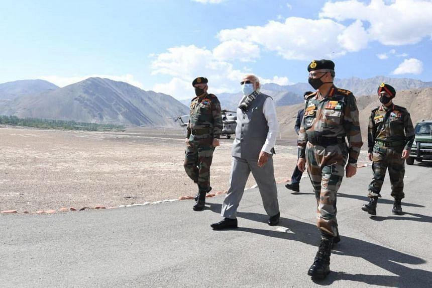 Indian Prime Minister Narendra Modi (second from left) and army officials arriving in Ladakh, India, on July 3, 2020.