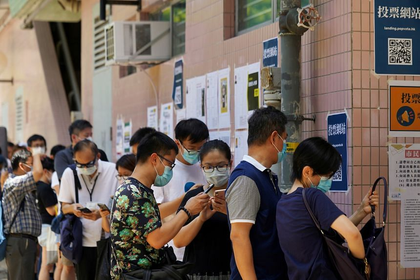People queueing up to vote in the primary election aimed at selecting the pan-democratic candidates for the September election, in Hong Kong, on July 12, 2020.