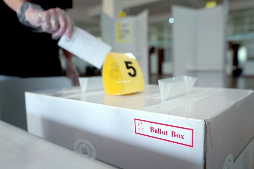 A photo illustration of a voter dropping the ballot paper into the ballot box.