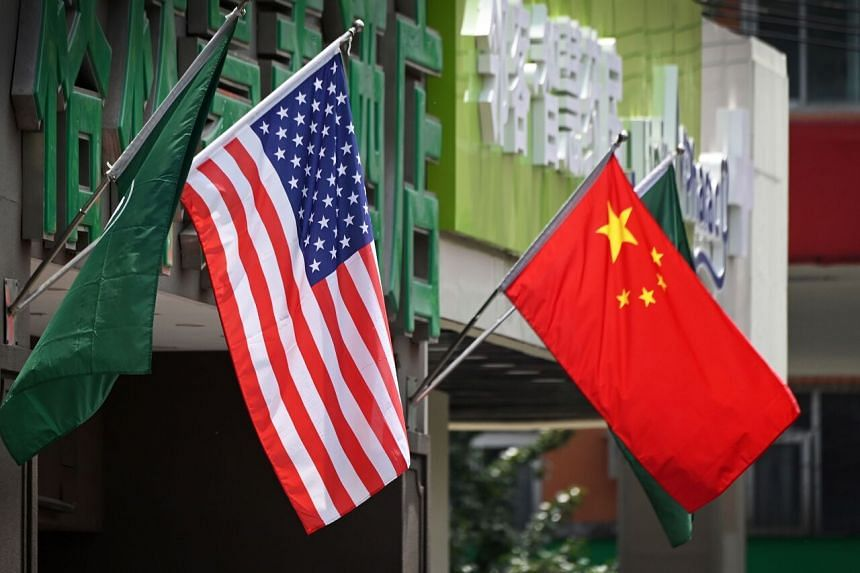 The US and Chinese flags as seen outside a hotel in Beijing on May 14, 2019.