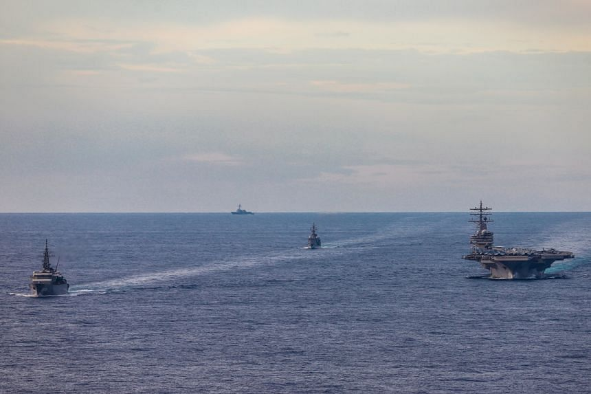 Japanese training ships conduct a passing exercise with USS Ronald Reagan in the South China Sea, on July 7, 2020.