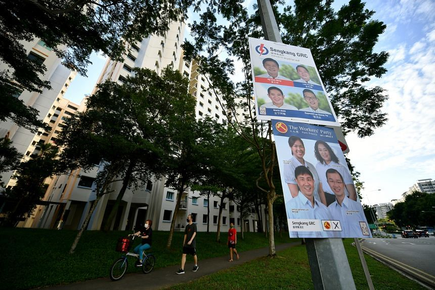 Election campaign posters for the PAP and WP as seen along Sengkang East Way on July 6, 2020.