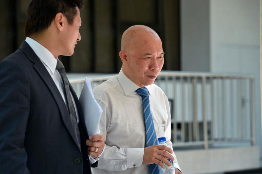 A file photo showing Dr Edward Foo (right), who is being sued, leaving the State Courts on April 14, 2014.